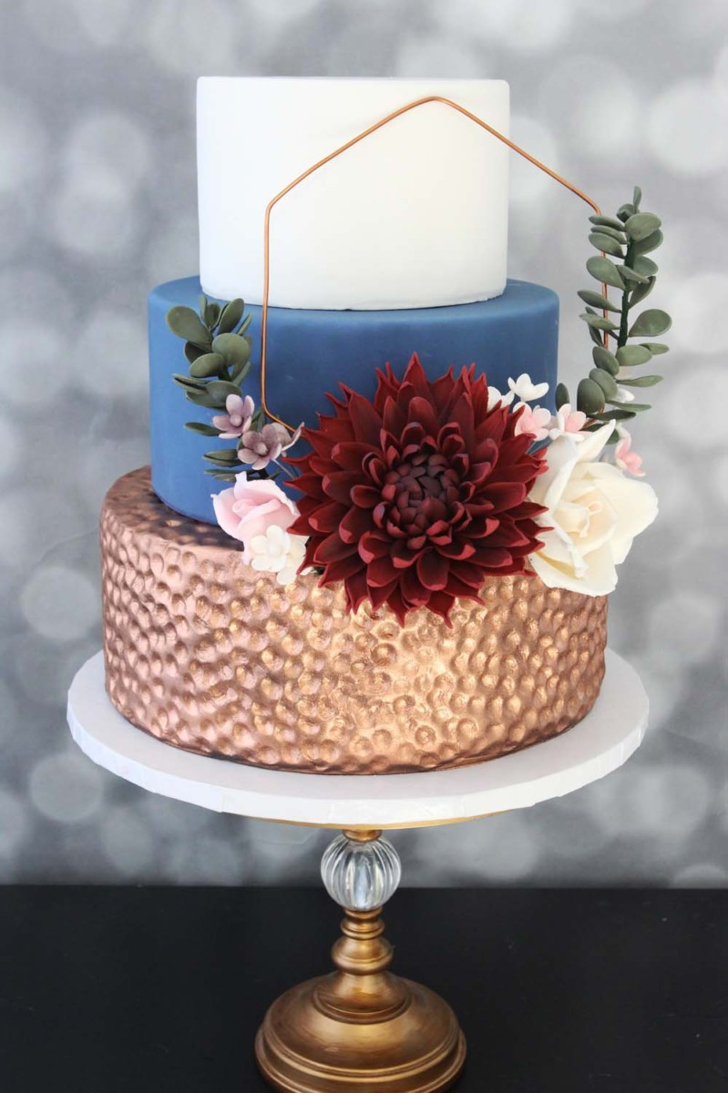 hammered copper eucalyptus bold flower and geometric shapes on this trendy wedding cake from nj bakery cafe pierrot
